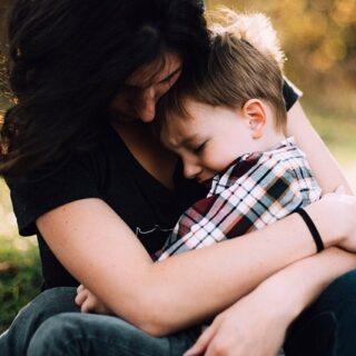 Mom hugging her son.
